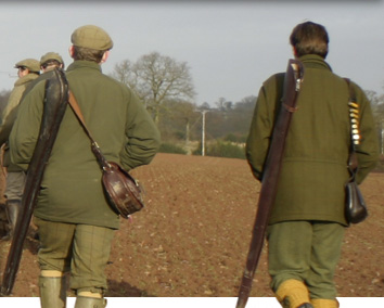 Image of the guns walking to the first drive at Willey Park shoot over a ploughed field